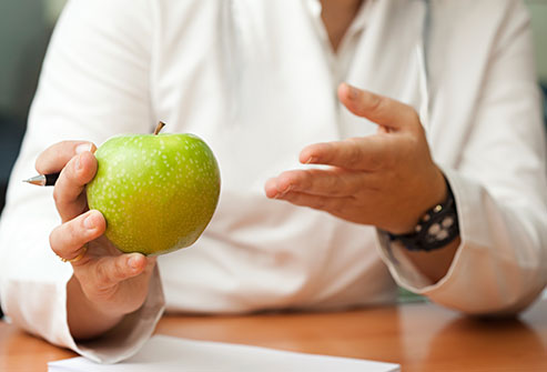 getty_rf_photo_of_nutritionist_with_apple